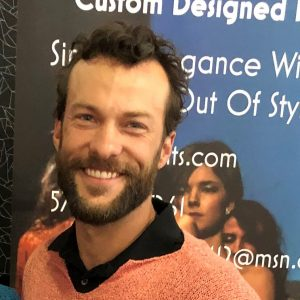 Photo of man wearing sweater